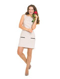 Full length portrait of smiling woman with rose Royalty Free Stock Photos