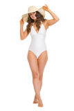 Full length portrait of smiling woman in swimsuit. Full length portrait of smiling young woman in swimsuit and hat Royalty Free Stock Image