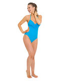 Full length portrait of smiling woman in swimsuit. Full length portrait of smiling young woman in swimsuit looking on copy space Stock Photos