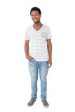 Full length portrait of a smiling young man Stock Photography