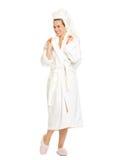 Full length portrait of smiling woman in bathrobe Royalty Free Stock Photos