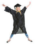 Smiling young woman in graduation gown jumping Stock Image