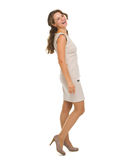 Full length portrait of smiling young woman Stock Photos