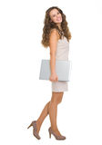 Full length portrait of smiling woman with laptop Stock Photos