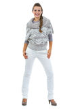 Full length portrait of smiling young woman in sweater Royalty Free Stock Photo