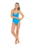 Full length portrait of smiling woman in swimsuit. Full length portrait of smiling young woman in swimsuit Stock Image