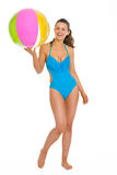 Full length portrait of smiling woman in swimsuit. Full length portrait of smiling young woman in swimsuit with beach ball Royalty Free Stock Photo