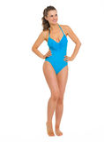 Full length portrait of smiling woman in swimsuit. Full length portrait of smiling young woman in swimsuit looking on copy space Stock Image