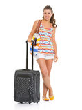 Full length portrait of woman with wheel bag Royalty Free Stock Photos