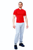 Full length portrait of a sports man standing Stock Photos