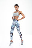 Full length portrait of a sporty afro american woman Royalty Free Stock Image