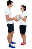 Full length portrait of sporty guy and girl Royalty Free Stock Photos