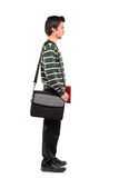 Full length portrait of a student with a bag. Full length portrait of a student with a school bag on his shoulder standing in line isolated on white background Royalty Free Stock Photography