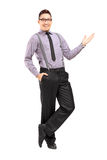 Full length portrait of a stylish smiling male posing Stock Photography