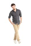 Full length portrait of a stylish young man standing with hands in pockets Stock Photos