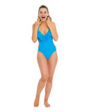 Full length portrait of surprised young woman in swimsuit Royalty Free Stock Images