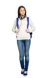 Full-length portrait of teenager with rucksack. And earphones, isolated on white Stock Photos