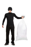 Full length portrait of a thief holding a bag. Isolated against white background Royalty Free Stock Photos