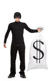 Full length portrait of a thief holding a bag. With US sign isolated against white background Royalty Free Stock Photo