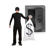 Full length portrait of a thief stealing Royalty Free Stock Image