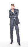 Full length portrait of thoughtful business man Royalty Free Stock Images