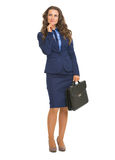 Full length portrait of thoughtful business woman with briefcase Stock Photos