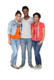 Full length portrait of three cool young friends Stock Photography