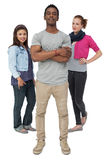 Full length portrait of three happy young people Royalty Free Stock Images