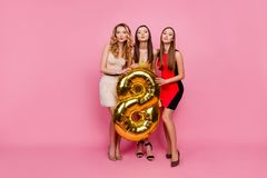 Full length portrait of three pretty, funny girls, blowing kiss royalty free stock photo