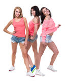 Full-length portrait of three sexy young women Stock Photos