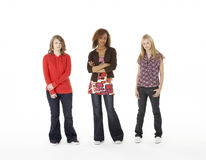 Full Length Portrait Of Three Teenage Girls Stock Photo