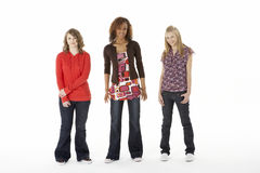 Full Length Portrait Of Three Teenage Girls Stock Photos