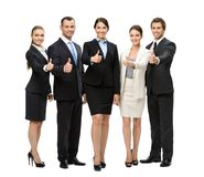 Full-length portrait of thumbing up group of business people Stock Image