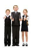 Full-length portrait of thumbing up little children Royalty Free Stock Photo