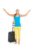 Full length portrait of tourist woman with wheel bag enjoying Royalty Free Stock Photography