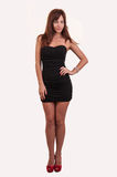 Full length portrait of trendy young woman in elegant black dresselegant black dres Stock Image