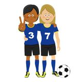 Full length portrait of two female soccer players hugging showing victory sign posing with ball Royalty Free Stock Photography