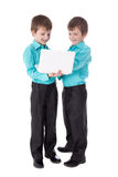 Full length portrait of two little boys twins using laptop isola Royalty Free Stock Images