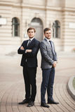 Full length portrait of two stylish businessmen royalty free stock images
