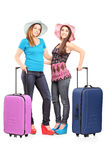 Full length portrait of two teenagers with suitcases stock photos