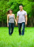 Full-length portrait of walking couple in park Stock Photography