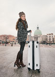 Full length portrait of woman with big luggage bag in Venice Stock Photo