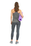 Full length portrait of woman with fitness mat Stock Photos