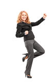 Full length portrait of a woman gesturing happiness Stock Image