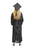 Full length portrait of woman in graduation gown Royalty Free Stock Image