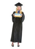 Full length portrait of woman in graduation gown Stock Photos