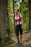 Full length portrait of a woman hiker in the woods Royalty Free Stock Image