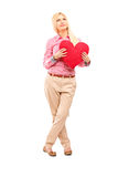 Full length portrait of a woman holding a red heart Stock Photo