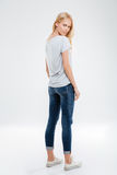 Full length portrait of a woman looking back at camera Royalty Free Stock Photos