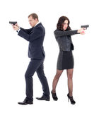 Full length portrait of woman and man shooting with guns isolate. Full length portrait of women and men shooting with guns isolated on white background Stock Photography